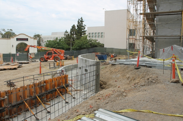 Some of the concrete has been poured for the handicap-accessible walkway on the northwest corner of Aztec Student Union.