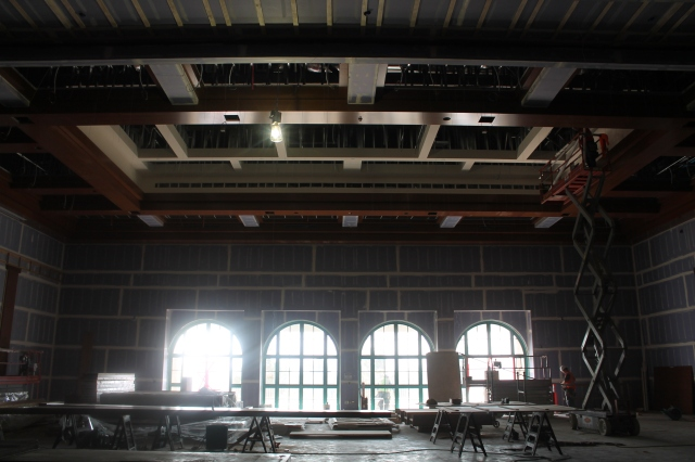Four arched windows shed light on the ceiling's millwork in Montezuma Hall.