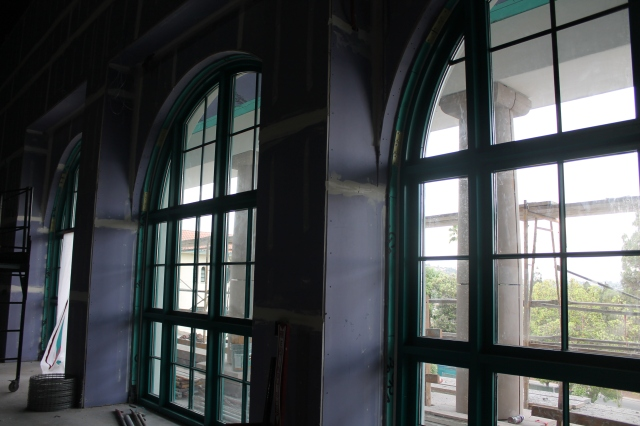 The arched windows in Montezuma Hall look out onto College Avenue.