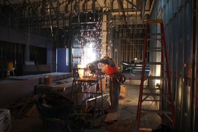 A crew member cuts framing in the cafe area of Aztec Student Union.