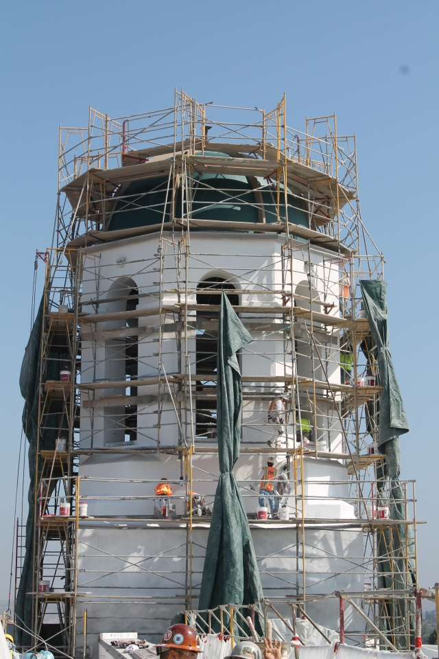 A dozen crew members complete work on the Union tower and dome.
