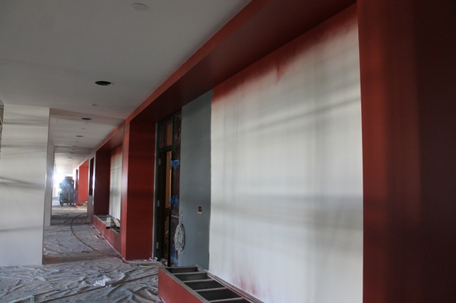 A red accent wall extends its way through the student organization offices area.