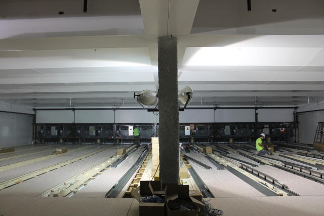 Workers install gutter systems in Aztec Lanes.