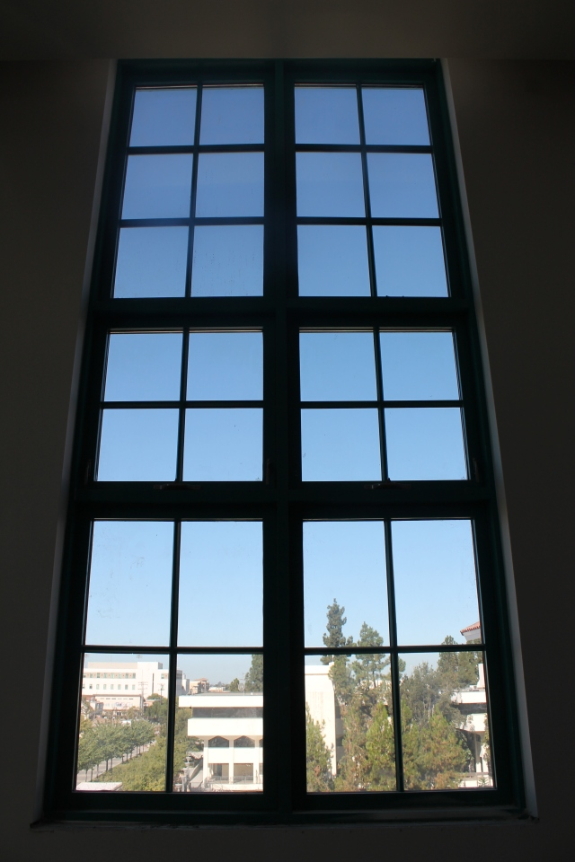 One of the large windows in the ARC Express provides a view of Adams Humanities.
