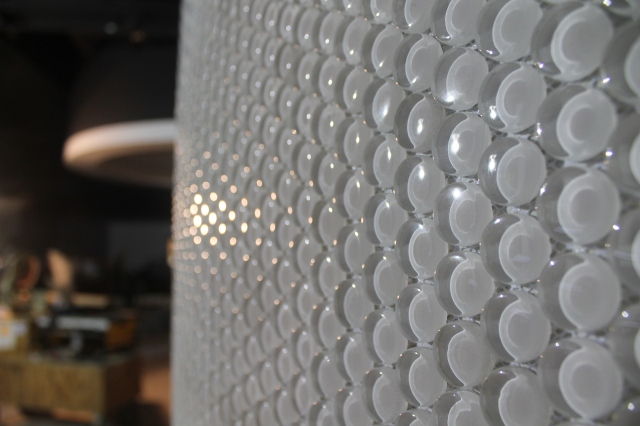 It may look like bubble wrap, but that's actually tile that is installed along a curved wall in Aztec Lanes.